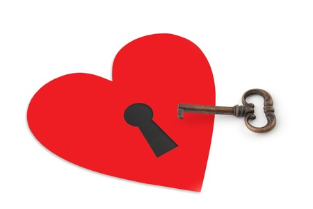 Key and heart on white background