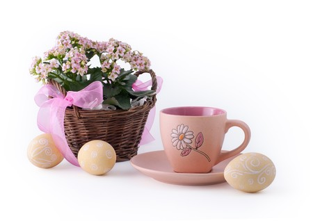 Easter eggs and basket with flower Stock Photo