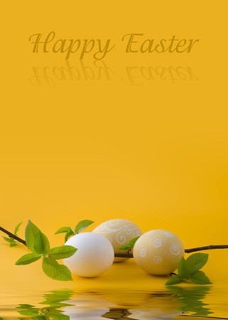 easter eggs on a yellow background with a blossoming out sprig