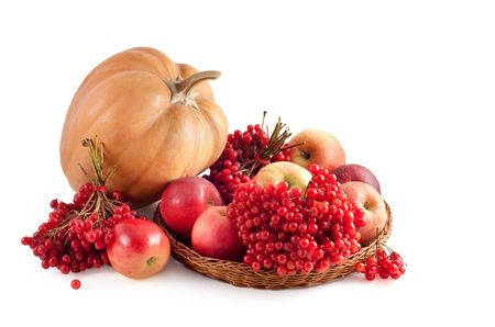 pumpkin and red apples on a white background