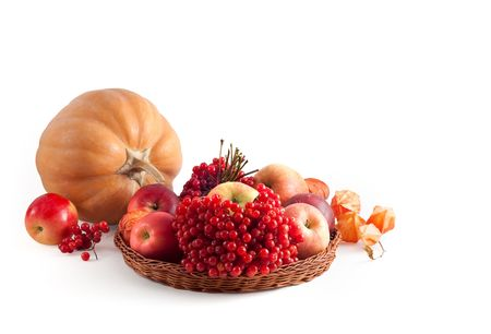Pumpkin and basket with fruit on a white background Stock Photo