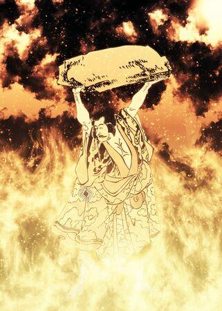 a person who lifts a rock in flames Foto de archivo