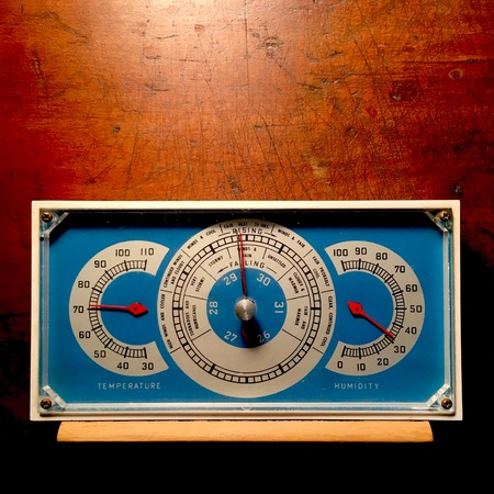 Retro blue barometer on weathered wood background. Reklamní fotografie