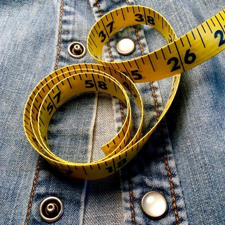 Measuring tape with western denim shirt.