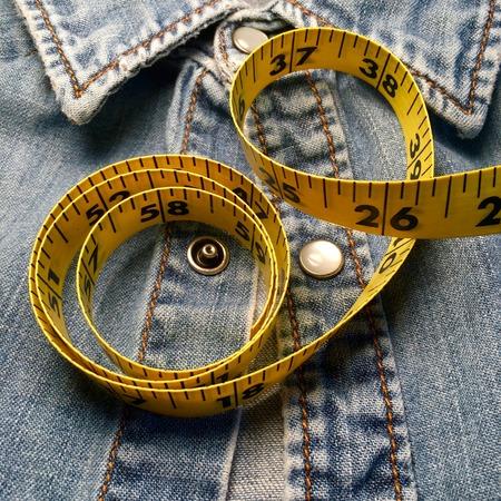 Tape measure on denim shirt.