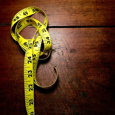 Tape measure on antique wood table