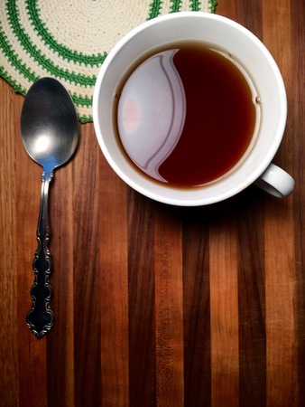 caffeinated: Hot beverage with vintage doily and spoon