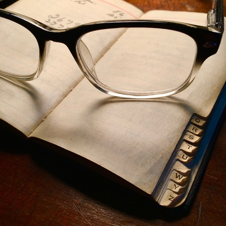 Retro spectacles with notebook