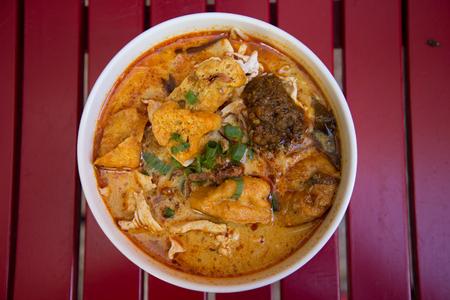 laksa: Chicken Laksa with tofu and sambal. Top view Stock Photo