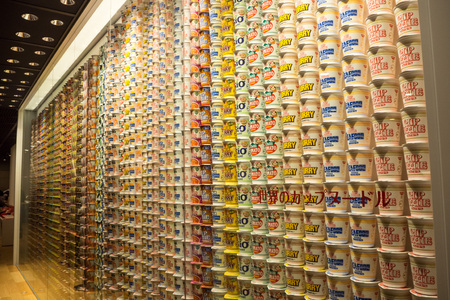 A wall showing some of Nissin's huge range of instant ramen products at the Instant Ramen Museum Editorial