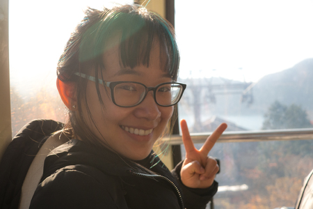 Female traveller on the Hakone Ropeway cable car during the sunset