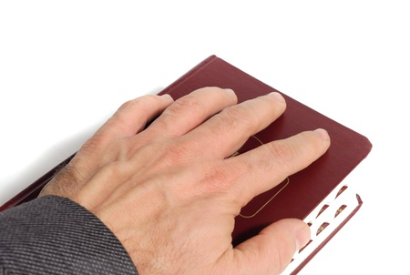 hand on a book