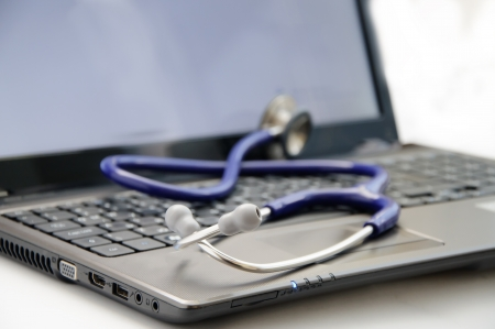 medical stethoscope on laptop  Diagnostic concept Stock Photo