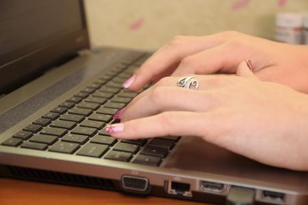 woman typing: woman typing on laptop keyboard