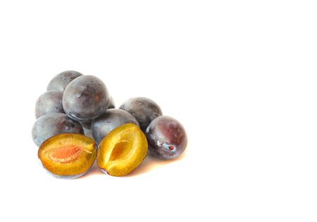 plums isolated on white background photo