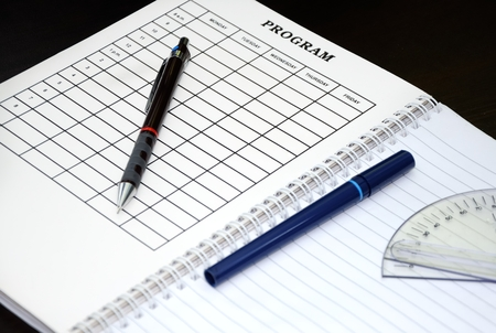 protractor: weekly planner with pen, rapidograph and protractor Stock Photo