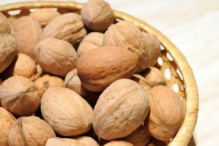 walnuts in shell in basket Stock Photo
