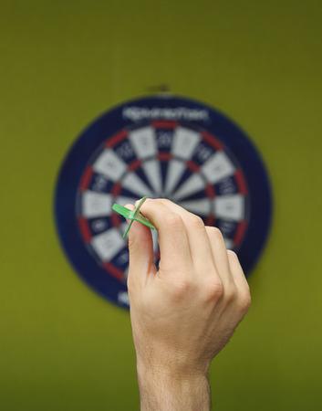 human hand with dart closeup  Stock Photo