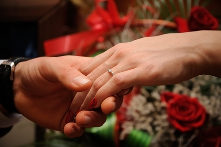 Engagement ring on womans hand held by her friend 版權商用圖片