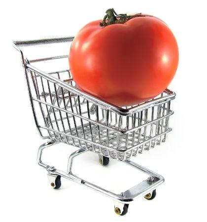 Ripe tomato in chrome shopping cart Stock Photo