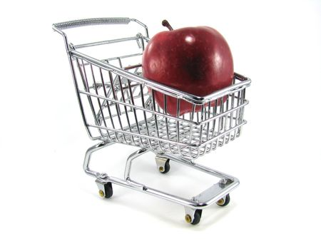 Apple in Miniature Shopping Cart Isolated on White Background Stock Photo