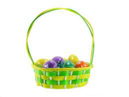 Zielonym i żółtym kolorze Wielkanocny koszyk z jaj odizolowane na białym Zdjęcie Seryjne