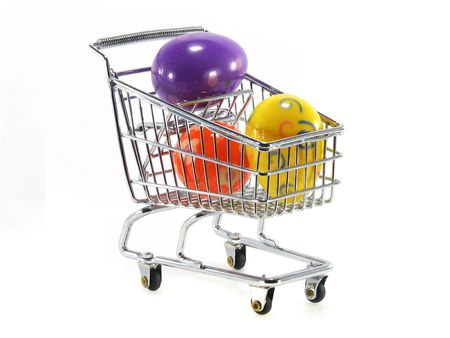 Miniature shopping cart with three colored easter eggs isolated on white background Stock Photo