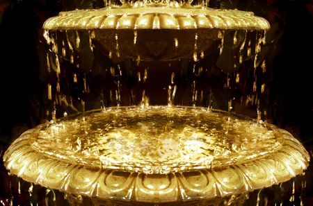 Abstract fountain flowing with liquid gold