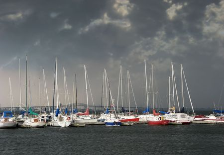 Storm closing in on sail boats in a marina
