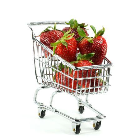 Fresh strawberries in miniature cart Stock Photo