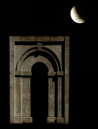 Arched stone doorway by moonlight
