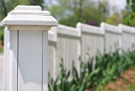 White picket fence with shallow depth of field