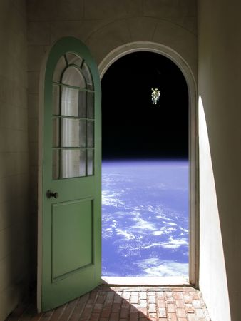 Arched doorway opening on black sky with Nasa image of astronaut Stock Photo