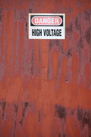 Portrait view of rusty high voltage cabinet Stock Photo