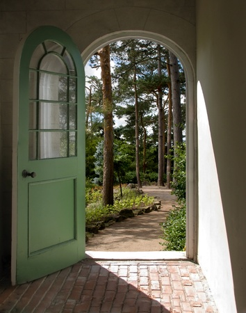 Arched Doorway to Sunlit Forest Stock Photo