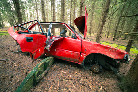 Red Wrecked car deep in the woods