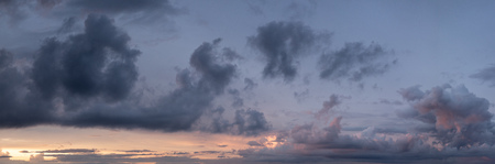 Panoramic clouds with orange and purple shot right as the sun disappeared beyond horizon.