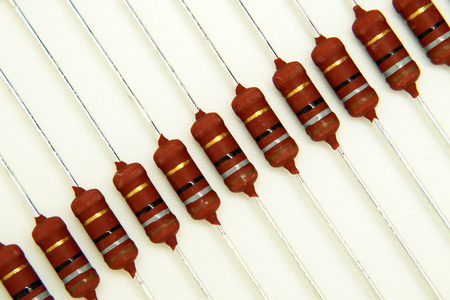Thru hole mounted resistors on a white background Stock Photo