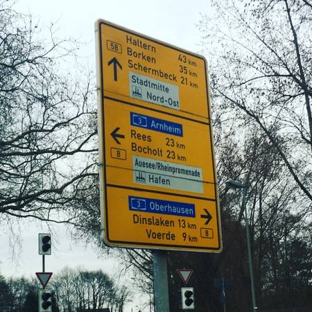 German sign with directions to autobahn and towns Stock Photo