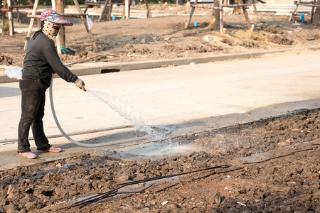 labor women watering  in construction site