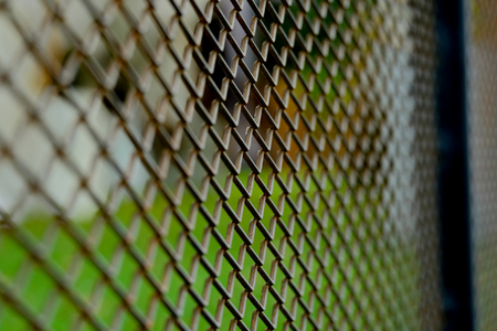 detain: Steel mesh background (Selective focus)