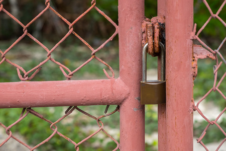 Close up Metal fence and padlock background. (Selective focus)
