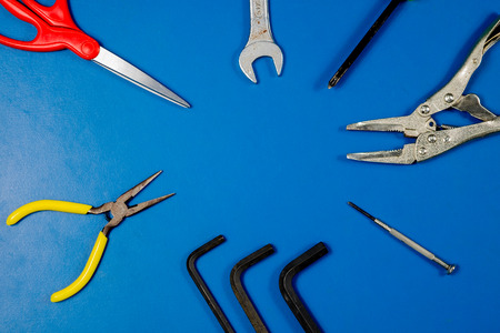 Tools on blue table for background. Stock Photo
