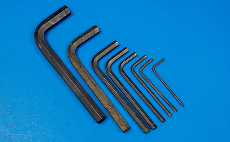 hex key: Hex key wrench set on blue table .