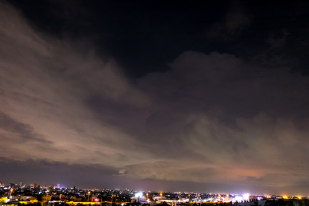 electricity background: night sky with lightning and storm in city,Bangkok,Thailand.(Selective focus)