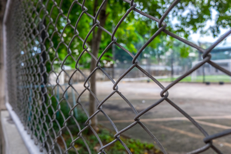 enclose: Close up Metal fence  background. (Selective focus) Stock Photo