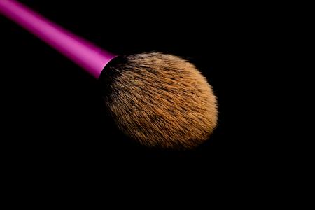 Brush Face makeup on black backgroud.