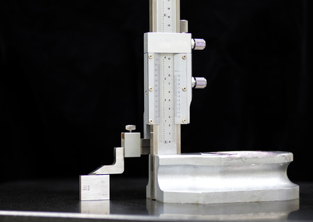 calibration: Calibration vernier high gauge with gauge block Stock Photo