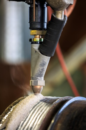 flux: Hard surfacing by submerge arc welding Stock Photo