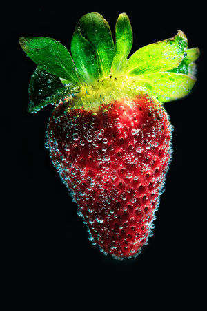 fresh strawberry into soda water